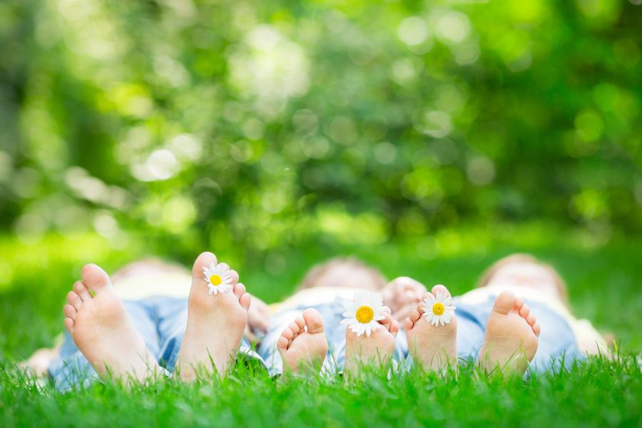 children-lying-on-grass